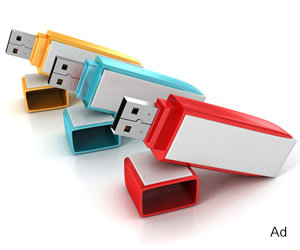 A selection of three flash drives on a table